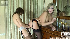 Toothsome babe in black stockings Nora is stroked by Laura C