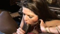 Busty June Summers gets on top of a big black dick and wildly rides it